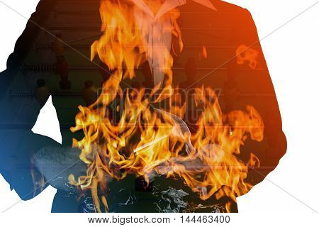 double exposure of business man and football and fire burn concept is bet of football is fire to burn
