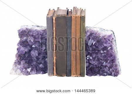Quartz purple gemstone amethyst and vintage books on white background