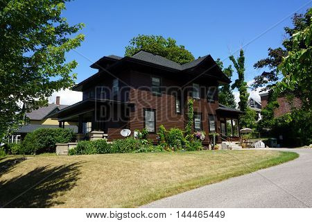 PETOSKEY, MICHIGAN / UNITED STATES - AUGUST 5, 2016: A large brown home near downtown Petoskey, Michigan.