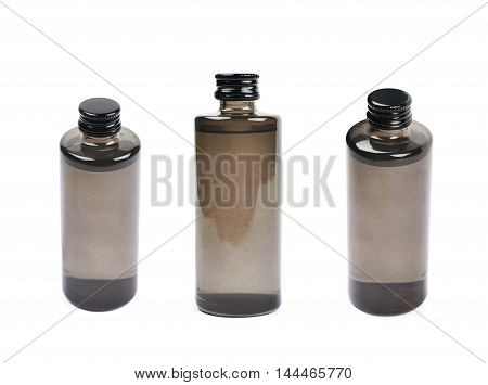 Black glass bottle vial isolated over the white background, set of three different foreshortenings