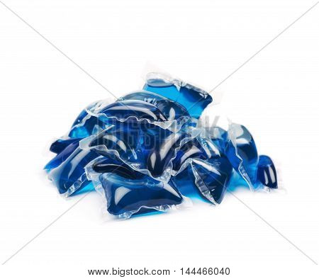 Pile of multiple washing pod capsules isolated over the white background