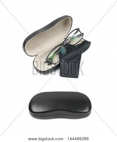 Black leather protection case box with the glasses over it, composition isolated over the white background, set of two different foreshortenings