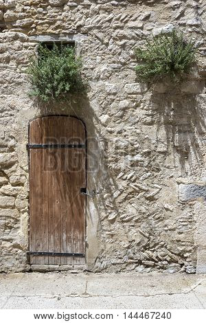 Old wooden doors in Saint-Saturnin-les-Apt France .