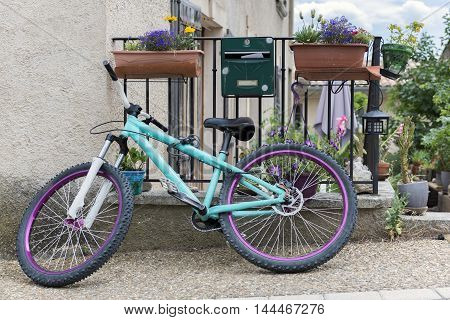 Small bicycle in front of house Provence France