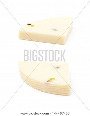 Slice fragment of white cheese with pistachio isolated over the white background, set of two different foreshortenings