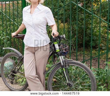 Young, beautiful elegantly dressed woman with Bicycle. Healthy lifestyle.