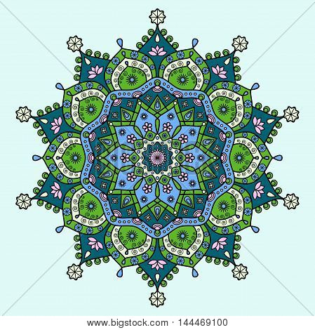 Mandala pattern in dark cyan blue, bright lime green, pink & creamy white on light blue background.