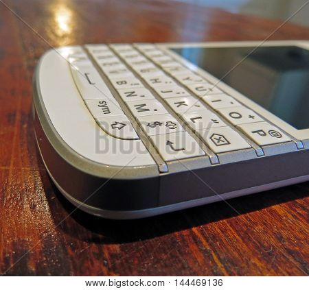 A qwerty keyboard on a business phone