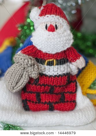 Knitted Santa Under Tree