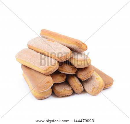 Pile of multiple ladyfinger savoiardi biscuit cookies, composition isolated over the white background