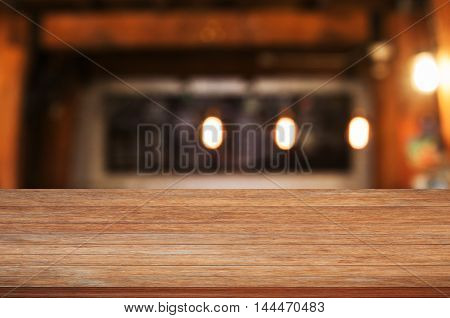 Top of wooden table top with coffee shop blurred abstract background