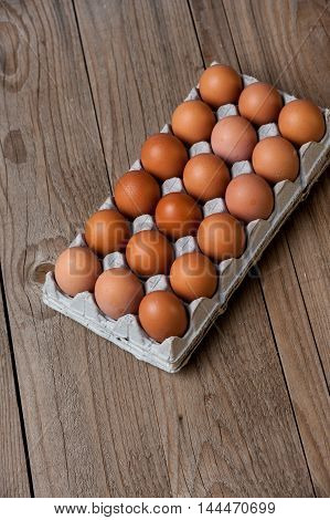 `Tray of Eggs on a wood background