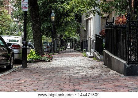 An old brick sidewalk in the middle of the city