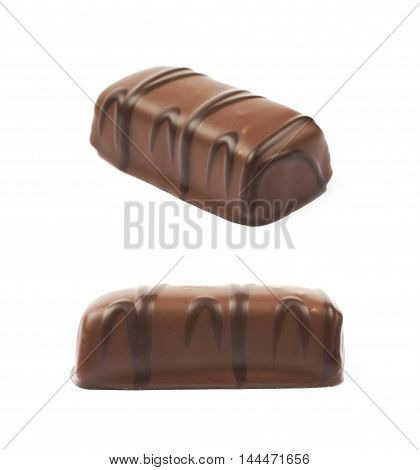 Chocolate confection candy isolated over the white background, set of two different foreshortenings