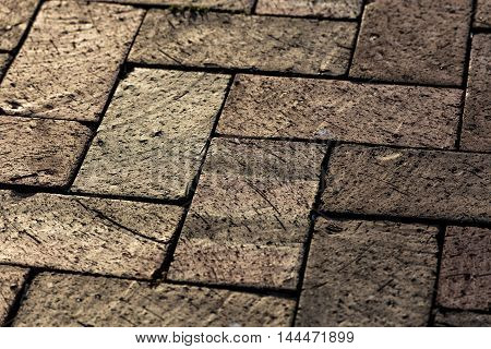 A brick floor with interesting textures in each square