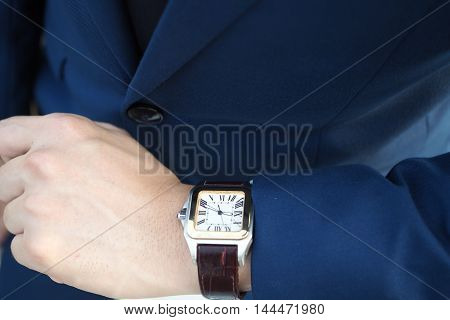 Businessman In Elegant Blue Suit Looking At Luxury Watch Waiting