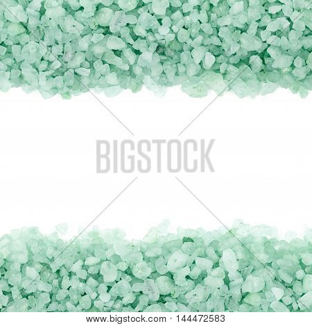 Copyspace backdrop composition with the borders made of salt crystals isolated over the white background