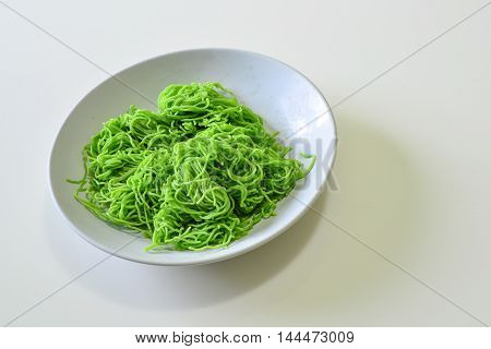 Green Noodles in the White Dish Preparation of Raw Food