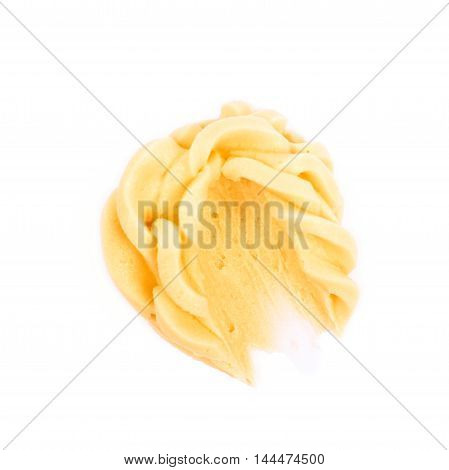 Smeared frosting cream isolated over the white background