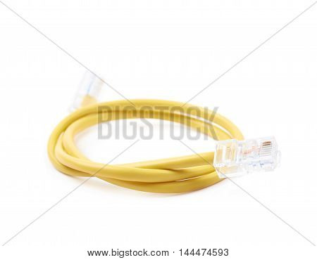 Folded yellow ethernet cable isolated over the white background