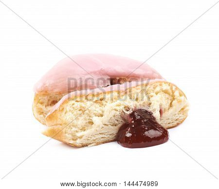 Half of a pink glazed donut isolated over the white background