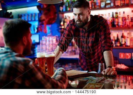 Barman at bar