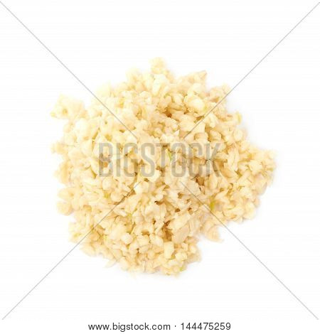 Pile of minced garlic isolated over the white background