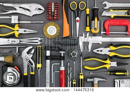 Set Of Different Hand Tools On Grey Background