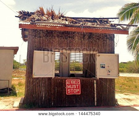 This is the toll booth for all vehicles crossing the bridge in San Pedro, Ambergris Caye, Belize.  Taken in July 2016.
