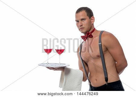 muscular waiter with drinks for women isolated