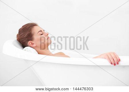 Beautiful girl relaxing in bathtub