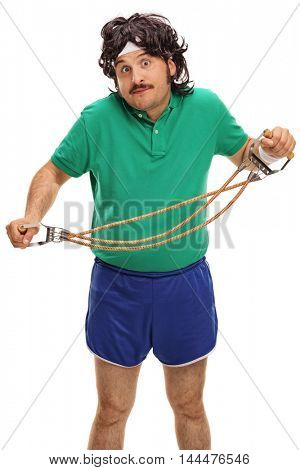 Retro guy trying to exercise with a resistance band isolated on white background
