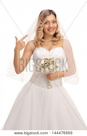 Joyful bride pointing at her hair and make-up isolated on white background