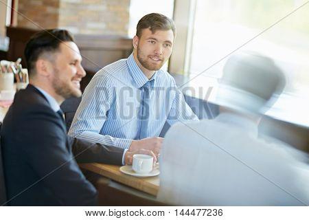Businessmen at cafe