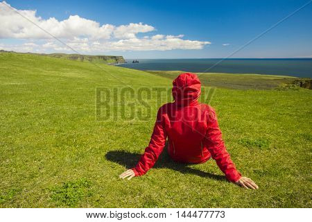 Woman sitting on the grass enjoying the nature