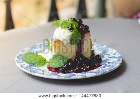 Homemade blueberry cake with whipped cream and fresh blueberry sweet sauce.(vintage effect and selective focus)