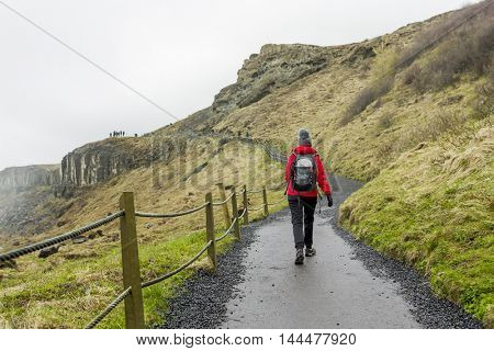 Shoot of a hiker woman walking at mountains in the winter