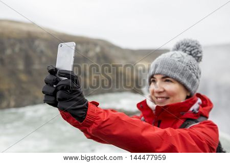Female tourist having fun and making a selfie