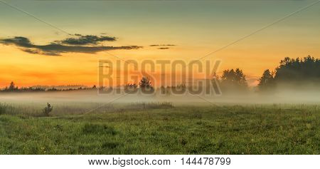 In the evening at sunset mist rose over fields