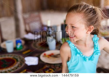 Casual portrait of little girl outdoors on summer vacation