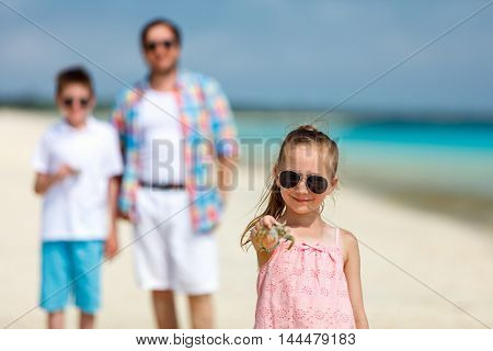 Father and kids enjoying beach vacation on tropical island