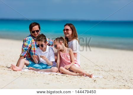 Happy beautiful family on a tropical beach vacation