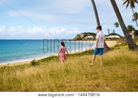 Kids exploring tropical beach during summer vacation