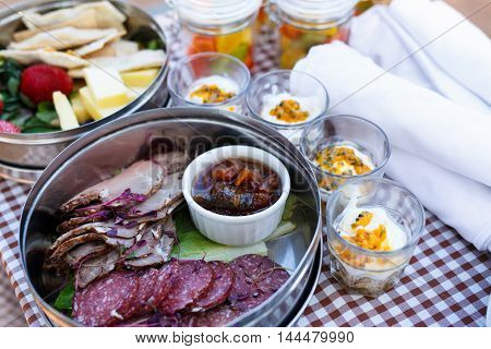 Luxury safari picnic bush breakfast with cheese and cold meat served and yogurt