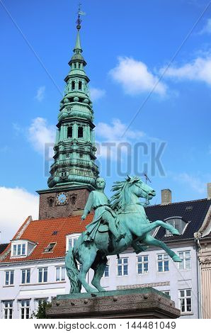 Hojbro Plads Square with the equestrian statue of Bishop Absalon and St Kunsthallen Nikolaj church in Copenhagen Denmark