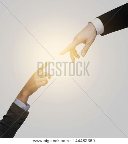 business and connection concept - woman and man hands trying to connect