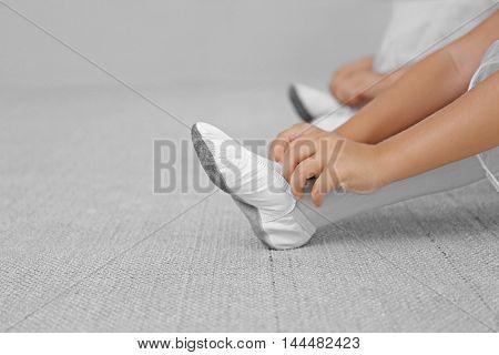 Little ballerinas sitting on the floor at ballet class