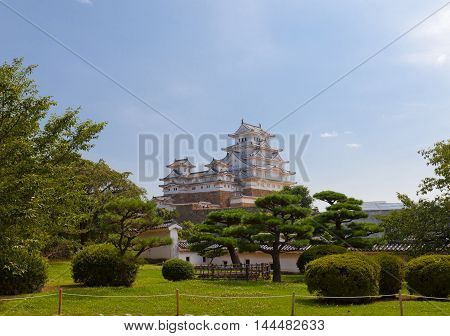 HIMEJI JAPAN - JULY 21 2016: View of main keep (tenshukaku) and small donjons of Himeji castle (White Egret Castle 1609) from West Bailey. National Treasure of Japan and UNESCO World Heritage Site