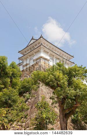 HIMEJI JAPAN - JULY 21 2016: Ka-no-yagura Turret of Himeji castle (White Egret Castle circa 1609). Himeji-jo is National Treasure of Japan and UNESCO World Heritage Site