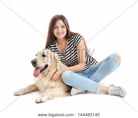 Beautiful girl hugging retriever, isolated on white